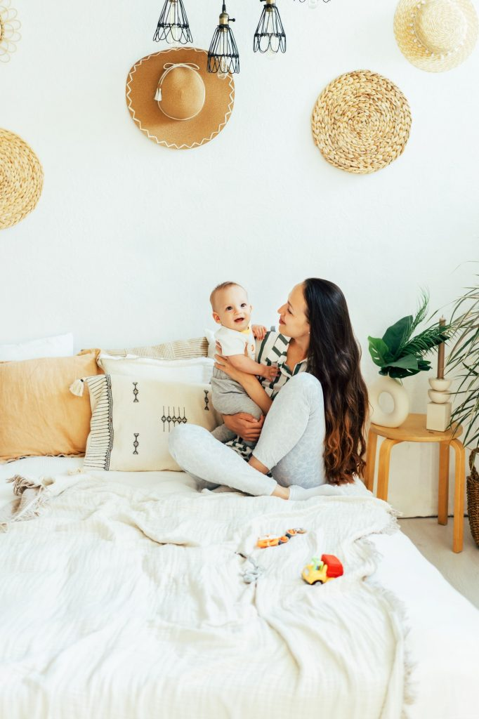 parent and child on bed